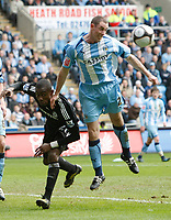 Photo: Steve Bond/Richard Lane Photography.<br />Coventry City v Chelsea. FA Cup 6th Round. 07/03/2009. Stephen Wright (R) clears in front of Salomon Kalou (L)