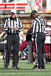 06 October 2012:  Referee Greg Sujack and Umpire Ed Feaster during an NCAA football game between the Southern Illinois Salukis and the Illinois State Redbirds at Hancock Stadium in Normal IL