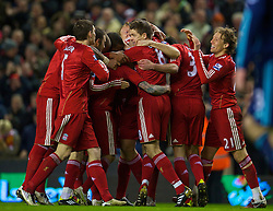 LIVERPOOL, ENGLAND - Wednesday, February 2, 2011: Liverpool's Raul Meireles celebrates scoring his side's first goal against Stoke City with team-mates during the Premiership match at Anfield. (Photo by David Rawcliffe/Propaganda)