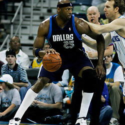 12 April 2009: Dallas Mavericks center Erick Dampier (25) is guarded by New Orleans Hornets forward Sean Marks (4) during NBA game between the New Orleans Hornets and the Dallas Mavericks on Easter Sunday at the New Orleans Arena in New Orleans, Louisiana.