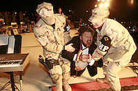 Al Franken as a condemned Saddam Hussein carried away by US Military MPs during a USO routine in Balad, Iraq..December 2006.. senator al franken