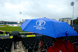 A fan looks on under an umbrella as rain continues to fall at the County Ground in Bristol ahead of the Cricket World Cup group match between Pakistan and Sri Lanka - Mandatory by-line: Robbie Stephenson/JMP - 07/06/2019 - CRICKET - County Ground - Bristol , England - Pakistan v Sri Lanka - ICC Cricket World Cup 2019 Group Stage