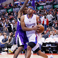 23 November 2013: Los Angeles Clippers small forward Jared Dudley (9) drives past Sacramento Kings shooting guard Ben McLemore (16) during the Los Angeles Clippers 103-102 victory over the Sacramento Kings at the Staples Center, Los Angeles, California, USA.