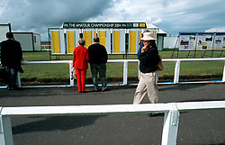 UK SCOTLAND ST ANDREWS 1-2JUN04 -  Spectators read the scoreboard on the Old Course during the qualifying round of the Amateur Championship 2004. The Royal and Ancient Golf Club of St. Andrews, Fife, Scotland is celebrating its 250th anniversary this year and is the governing authority for the rules of the game in more than 100 affiliated nations and is responsible for the Open Championship and key amateur and international events. The R & A is also dedicated to the development of golf world-wide and is a leader in environmental and ecological research.......jre/Photo by Jiri Rezac....© Jiri Rezac 2004....Contact: +44 (0) 7050 110 417..Mobile:  +44 (0) 7801 337 683..Office:  +44 (0) 20 8968 9635....Email:   jiri@jirirezac.com..Web:     www.jirirezac.com....© All images Jiri Rezac 2004 - All rights reserved...
