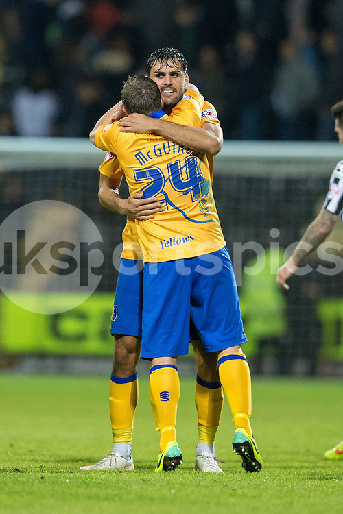 Mansfield Town's Chris Clements and Jamie Mcguire celebrate at full time during the Sky Bet League 2 match between Notts County and Mansfield Town at Meadow Lane, Nottingham, England on 14 August 2015. Photo by James Williamson.