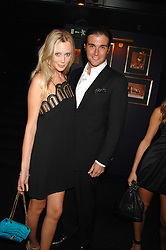 LISA HENREKSON and DAVID PEACOCK at a party to celebrate the publication of the 2007 Tatler Little Black Book held at Tramp, 40 Jermyn Street, London on 7th November 2007.<br />