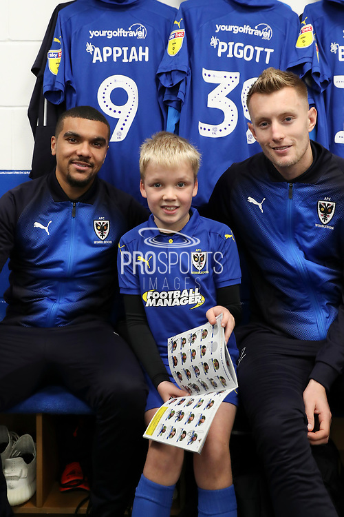 AFC Wimbledon striker Kweshi Appiah (9), AFC Wimbledon striker Joe Pigott (39) and mascot during the EFL Sky Bet League 1 match between AFC Wimbledon and Southend United at the Cherry Red Records Stadium, Kingston, England on 24 November 2018.
