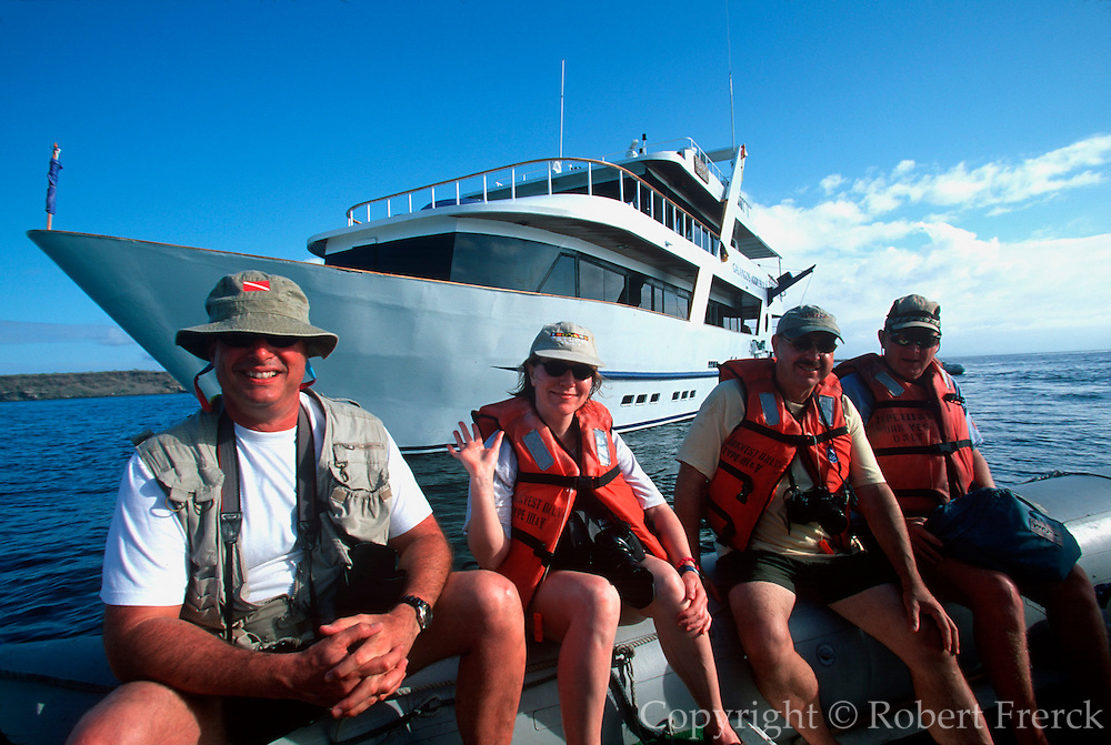 ECUADOR, GALAPAGOS eco-tourists coming to see sea lions