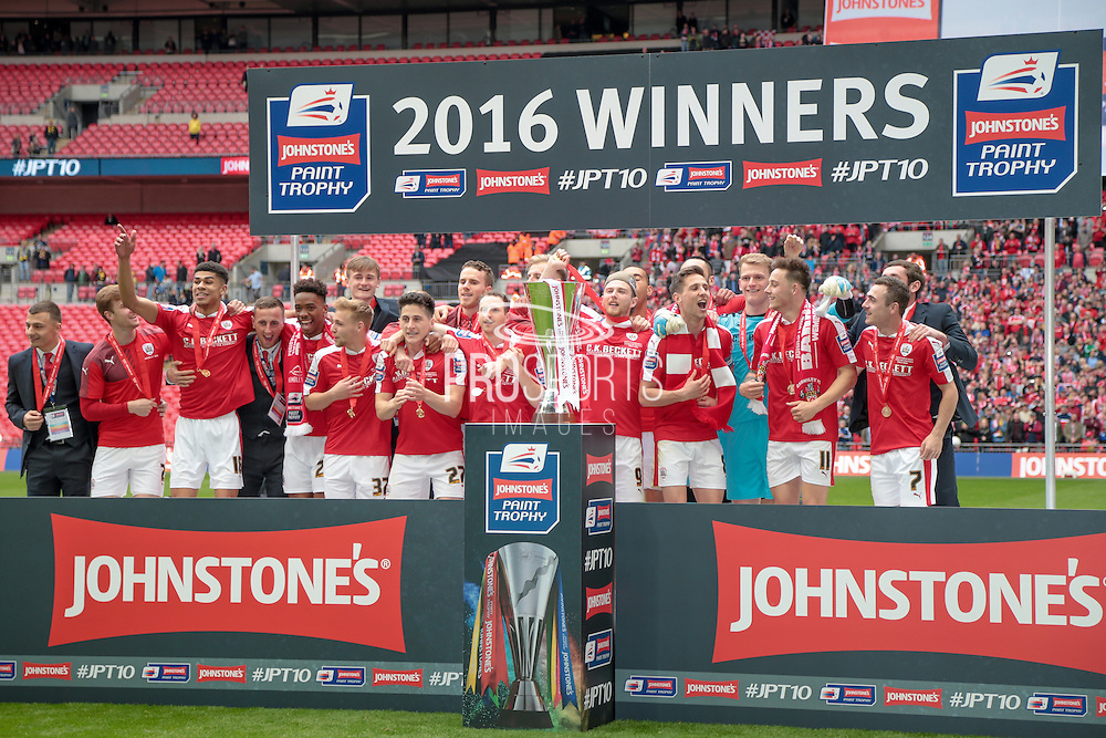 Barnsley on the winner's podium with the trophy during the Johnstone's Paint Trophy Final between Barnsley and Oxford United at Wembley Stadium, London, England on 3 April 2016. Photo by Mark P Doherty.