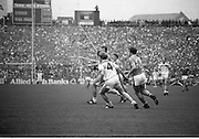 The All Ireland Senior Football Final.1982.19.09.1982.09.19.1982.19th September 1982..The senior final was contested between Offaly and Kerry. Offaly won the title by the narrowest of margins 1.15 to 17 points..Lowry (4) and Sheehy(13) chase out to the ball.