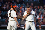 San Francisco Giants starting pitcher Ty Blach (50) talks with San Francisco Giants catcher Nick Hundley (5) at the mound against the Cincinnati Reds at AT&T Park in San Francisco, California, on May 11, 2017. (Stan Olszewski/Special to S.F. Examiner)