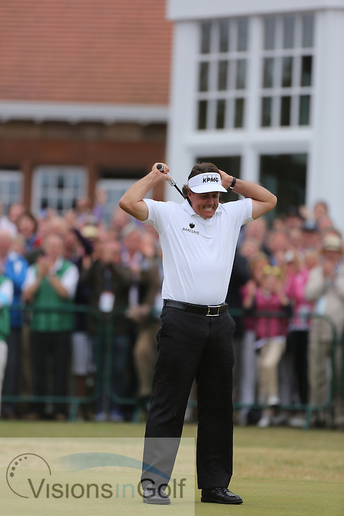 Phil Mickelson holes the final putt to win the tournament before he is presented with the claret jug trophy<br /> on the final day at The Open Championship 2013, Muirfield, Scotland<br /> Picture Credit:  Mark Newcombe / visionsingolf.com