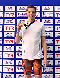 The medal ceremony for the Men's 100m Freestyle, gold medalist Duncan Scott during day three of the 2017 British Swimming Championships at Ponds Forge, Sheffield.