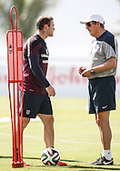 England manager Roy Hodgson (R) speaks to Wayne Rooney of England during the England open training session at Est&aacute;dio Claudio Coutinho, Urca, Rio de Janeiro<br /> Picture by Andrew Tobin/Focus Images Ltd +44 7710 761829<br /> 16/06/2014