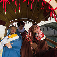 VENICE, ITALY - DECEMBER 26:  A real Venetian couple with their one month old son perform a live nativity scene, and are being ferried in gondola from St Mark's to the Island of S Giorgio on December 26, 2011 in Venice, Italy.  The event is in its first year wants and to replicate an ancient tradition when the Doge of Venice used to go to the Island of S Giorgio to celebrate the relics of Santo Stefano on Boxing Day. HOW TO LICENCE THIS PICTURE: please contact us via e-mail at sales@xianpix.com or call our office London   +44 (0)207 1939846 for prices and terms of copyright. First Use Only ,Editorial Use Only, All repros payable, No Archiving.© MARCO SECCHI