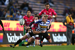 Scott van Breda of Western Province gets his pass away as Tyler Fisher of the Pumas makes the tackle during the Currie Cup Premier Division match between the DHL Western Province and the Pumas held at the DHL Newlands rugby stadium in Cape Town, South Africa on the 17th September  2016<br /> <br /> Photo by: Shaun Roy / RealTime Images
