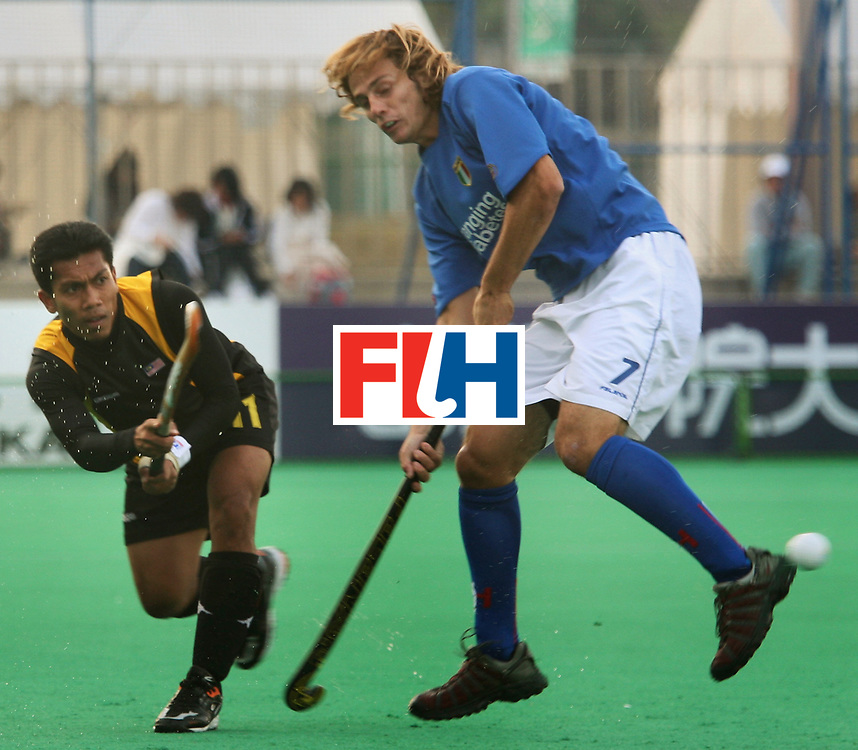 Kakamigahara (Japan): Sharun Nabil of Malaysia who scored two goals seen sends the ball past Nunez Agustin in the Olympic Hockey Qualifier at Gifu Perfectural Green Stadium at Kakamigahara on 06 April 2008. Malaysia drew with Italy 4-4.  Photo: GNN/ Vino John