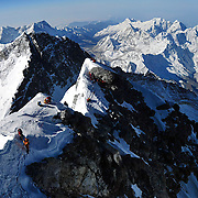 Panorama of climbers ascending the final 250 feet of the Southeast Ridge of Everest as viewed from the top of the Hillary Step, on May 19, 2009.