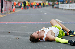 An athlete is seen laying on the street, a few yards behind the finish line, imidiatly after finishing the November 22, 2015 Philadelphia Marathon, in Center City Philadelphia, PA. (Photo by Bastiaan Slabbers)<br /> <br /> Download and license this photo: http://www.istockphoto.com/photo/emotions-at-finish-line-of-philadelphia-marathon-79533681