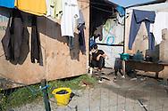 Calais, Pas-de-Calais, France - 23.10.2016    <br />  <br /> Last day of the of the so called &rdquo;Jungle&quot; refugee camp on the outskirts of the French city of Calais before the scheduled eviction. Many thousands of migrants and refugees are waiting in some cases for years in the port city in the hope of being able to cross the English Channel to Britain. French authorities announced that they will shortly evict the camp where currently up to up to 10,000 people live.<br /> <br /> Letzter Tag des sogenannten &rdquo;Jungle&rdquo; Fluechtlingscamp am Rande der franzoesischen Stadt Calais vor der angesetzten Raeumung. Viele tausend Migranten und Fluechtlinge harren teilweise seit Jahren in der Hafenstadt aus in der Hoffnung den Aermelkanal nach Gro&szlig;britannien ueberqueren zu koennen. Die franzoesischen Behoerden kuendigten an, dass sie das Camp, indem derzeit bis zu bis zu 10.000 Menschen leben K&uuml;rze raeumen werden. <br /> <br /> Photo: Bjoern Kietzmann.10.2016    <br />  <br /> Some Afghan refugees burn sleeping bags and other belongings inside the camp. Last day of the of the so called &rdquo;Jungle&quot; refugee camp on the outskirts of the French city of Calais before the scheduled eviction. Many thousands of migrants and refugees are waiting in some cases for years in the port city in the hope of being able to cross the English Channel to Britain. French authorities announced that they will shortly evict the camp where currently up to up to 10,000 people live.<br /> <br /> Einige afghanische Fluechtlinge verbrennen Schlafsaecke und andere Habseligkeiten im Camp. Letzter Tag des sogenannten &rdquo;Jungle&rdquo; Fluechtlingscamp am Rande der franzoesischen Stadt Calais vor der angesetzten Raeumung. Viele tausend Migranten und Fluechtlinge harren teilweise seit Jahren in der Hafenstadt aus in der Hoffnung den Aermelkanal nach Gro&szlig;britannien ueberqueren zu koennen. Die franzoesischen Behoerden kuendigten an, dass sie das Camp, indem derzeit bis z