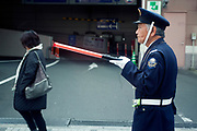 Japan elderly man working as parking attendant