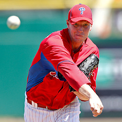 March 25, 2012; Clearwater, FL, USA; Philadelphia Phillies starting pitcher Roy Halladay (34) throws against the Baltimore Orioles during the top of the first inning of a spring training game at Bright House Networks Field. Mandatory Credit: Derick E. Hingle-US PRESSWIRE