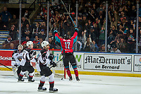 KELOWNA, CANADA - MARCH 16: Alex Swetlikoff #17 of the Kelowna Rockets celebrates the game winning goal during overtime against the Vancouver Giants on March 16, 2019 at Prospera Place in Kelowna, British Columbia, Canada.  (Photo by Marissa Baecker/Shoot the Breeze)