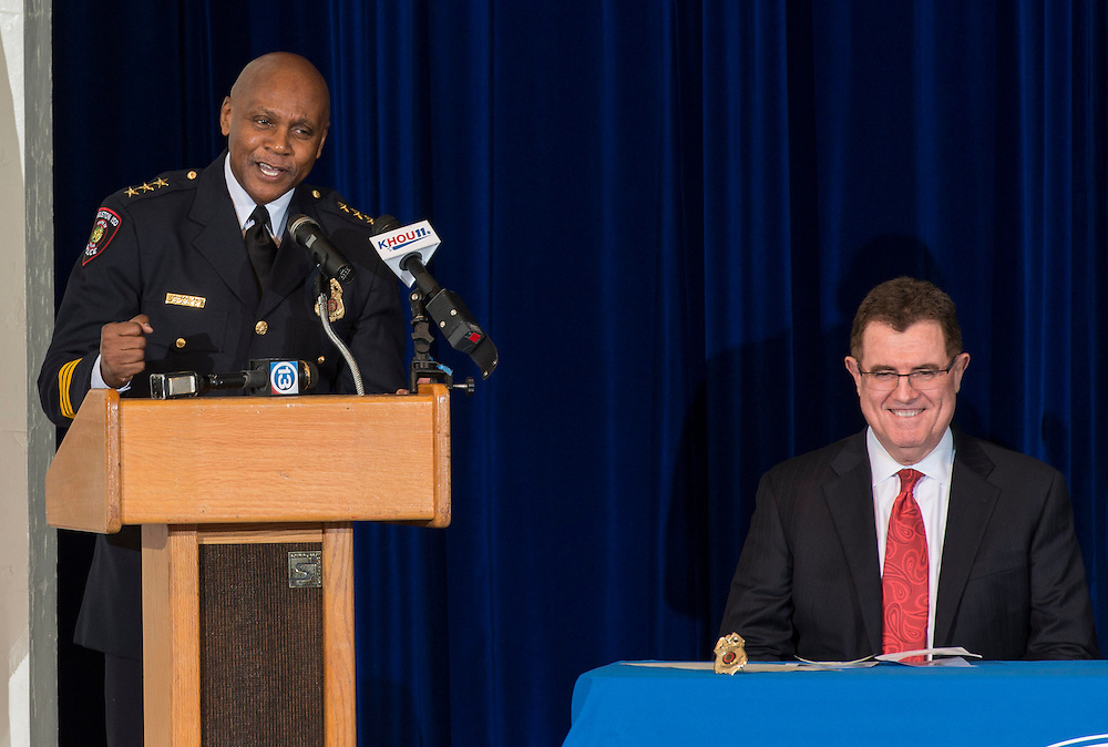 Retiring Houston ISD Chief of Police Jimmy Dotson, left, comments as Superintendent Dr. Terry Grier listens during the swearing-in ceremony for new Chief of Police Robert Mock, January 6, 2014, at the High School for Law Enforcement and Criminal Justice.