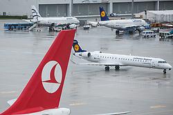THEMENBILD - Airport Muenchen, Franz Josef Strauß (IATA: MUC, ICAO: EDDM), Der Flughafen Muenchen zählt zu den groessten Drehkreuzen Europas, rund 100 Fluggesellschaften verbinden ihn mit 230 Zielen in 70 Laendern, im Bild Seitenruder einer Turkish Airways Maschine mit Logo und ein Lufthansa CityLine Canadair CL-600-2D24 Regional Jet // THEME IMAGE, FEATURE - Airport Munich, Franz Josef Strauss (IATA: MUC, ICAO: EDDM), The airport Munich is one of the largest hubs in Europe, approximately 100 airlines connect it to 230 destinations in 70 countries. picture shows: Rudder of a Turkish Airlines with logo and a Lufthansa CityLine Canadair CL-600-2D24 Regional Jet, Munich, Germany on 2012/05/06. EXPA Pictures © 2012, PhotoCredit: EXPA/ Juergen Feichter