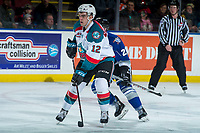 KELOWNA, CANADA - FEBRUARY 12: Erik Gardiner #12 of the Kelowna Rockets looks for the pass against the Victoria Royals  on February 12, 2018 at Prospera Place in Kelowna, British Columbia, Canada.  (Photo by Marissa Baecker/Shoot the Breeze)  *** Local Caption ***