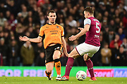 Wolverhampton Wanderers defender Ryan Bennett (5) passes through the legs of Aston Villa defender James Chester (5) during the EFL Sky Bet Championship match between Aston Villa and Wolverhampton Wanderers at Villa Park, Birmingham, England on 10 March 2018. Picture by Dennis Goodwin.