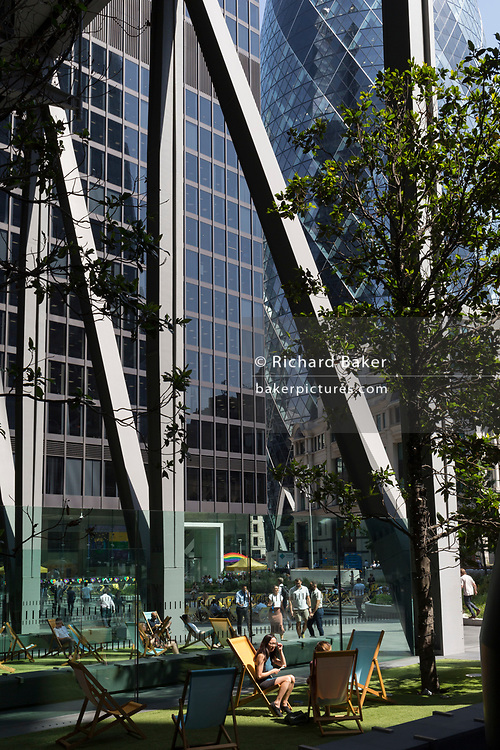 As heatwave temperatures climb to record levels - the hottest day of the year so far - Londoners in the City of London (the capital's financial district aka the Square Mile) enjoy sunshine in Leadenhall, on 25th July 2019, in London, England.