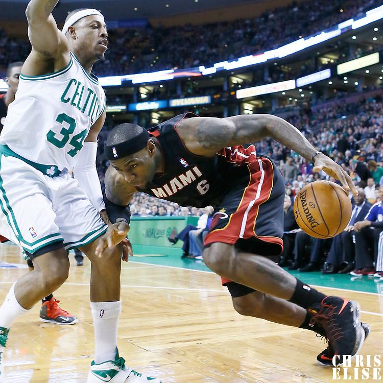 27 January 2013: Miami Heat small forward LeBron James (6) drives past Boston Celtics small forward Paul Pierce (34) during the Boston Celtics 100-98  2OT victory over the Miami Heat at the TD Garden, Boston, Massachusetts, USA.