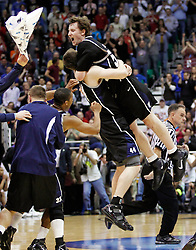 Butler's Andrew Smith, left, and Matt Howard celebrate after their 63-56 win over Kansas State in the NCAA West Regional final college basketball game in Salt Lake City, Saturday, March 27, 2010. (AP Photo/Colin E. Braley).