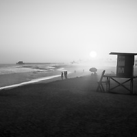 Newport Beach California Lifeguard Tower M sunset black and white photo. Balboa Peninsula is a popular area of Newport Beach along the Pacific Ocean in Orange County Southern California. Photo is high resolution. Copyright ⓒ 2017 Paul Velgos with All Rights Reserved.