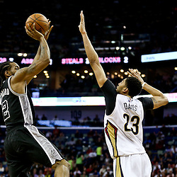 Mar 3, 2016; New Orleans, LA, USA; San Antonio Spurs forward Kawhi Leonard (2) shoots over New Orleans Pelicans forward Anthony Davis (23) during the fourth quarter of a game at the Smoothie King Center. The Spurs defeated the Pelicans 94-86. Mandatory Credit: Derick E. Hingle-USA TODAY Sports