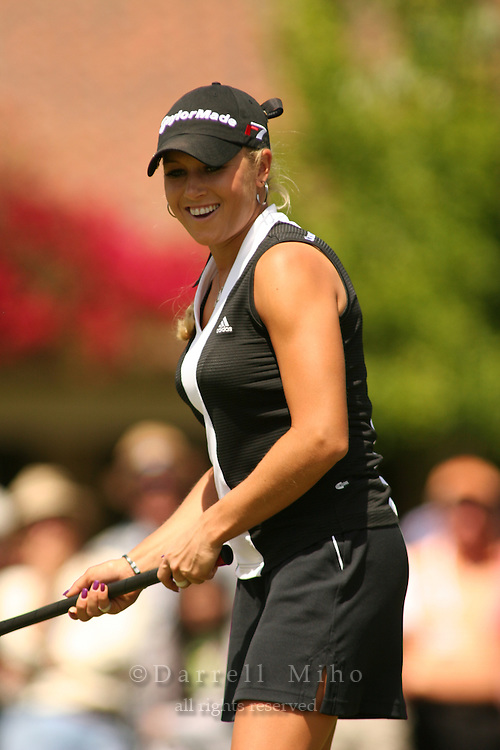 Apr. 2, 2006; Rancho Mirage, CA, USA; Natalie Gulbis smiles as she watches her putt roll in for a par on the 12th hole at the Kraft Nabisco Championship at Mission Hills Country Club...Mandatory Photo Credit: Darrell Miho.Copyright © 2006 Darrell Miho .