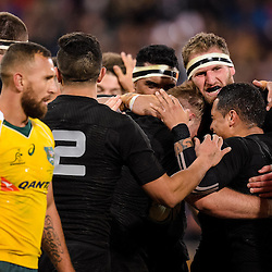 The All Blacks celebrate Sam Cane's try while Quade Cooper walks by during the Investec Rugby Championship match between the New Zealand All Blacks and the Australia Wallabies at Westpac Stadium in Wellington, New Zealand on Saturday, 27 August 2016. Photo: Marco Keller / www.lintottphoto.co.nz