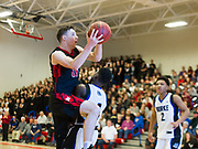 Watertown High School  senior captain John Korte drives to the basket during the MIAA Division 3 state semifinal game against Jeremiah E. Burke High School in Burlington, March 14, 2018. The Raiders won the game, 66-61. [Wicked Local Photo/James Jesson]