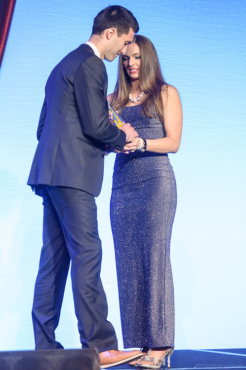 Amber Gell, rocket scientist from Lockheed Martin and NASA, presents one of the six Core Principle Awards, the Confidence award, to Josh Nesbit of Waterford, Virginia at the fourth annual Muhammad Ali Humanitarian Awards Saturday, Sept. 17, 2016 at the Marriott Hotel in Louisville, Ky. (Photo by Brian Bohannon for the Muhammad Ali Center)