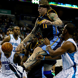 Dec 18, 2009; New Orleans, LA, USA; A loose ball goes off the foot of Denver Nuggets center Chris Andersen (11) against the New Orleans Hornets during the second half at the New Orleans Arena. The Hornets defeated the Nuggets 98-92. Mandatory Credit: Derick E. Hingle-US PRESSWIRE