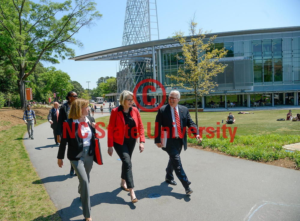 Ms. Spelling, center, walks with NC State Chancellor Randy Woodson, right, and University Architect Lisa Johnson in front of the Talley Student Union while on campus.
