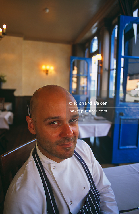 Theodore Kyriakou is seen in his Real Greek restaurant in Hoxton, East London. He smiles to the view dressed in chef's apron and with a pen behind his ear. This Greek-born chef once served in the military but realised his ambition to cook by coming to London and eventually being the co-owner of Livebait, the renowned London fish restaurant chain. In 1999, he finally opened a restaurant specialising in the kind of food his mother used to make. The Real Greek was in business, recreating many of the dishes he remembered, he introduced authentic Greek cuisine to a new audience. Kyriakou's parents ran a deli in Athens. His mother, a natural cook, didn't follow recipes, though many of her dishes are influenced by a 2,000-year-old cookbook, the Deipnosophistai by Athenaeus. She still gets calls from her son to check facts.