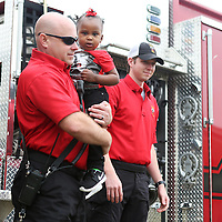 Lauren Wood | Buy at photos.djournal.com<br /> Sgt. Kevin Fulghan holds Khloe Harris as he and other firefighters from Tupelo Station No. 5 visit the Brown Bear Child Care and Learning Center Wednesday morning.
