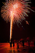 Fireworks explode along the beach at Isle of Palms, SC marking Independence Day, July 4th.