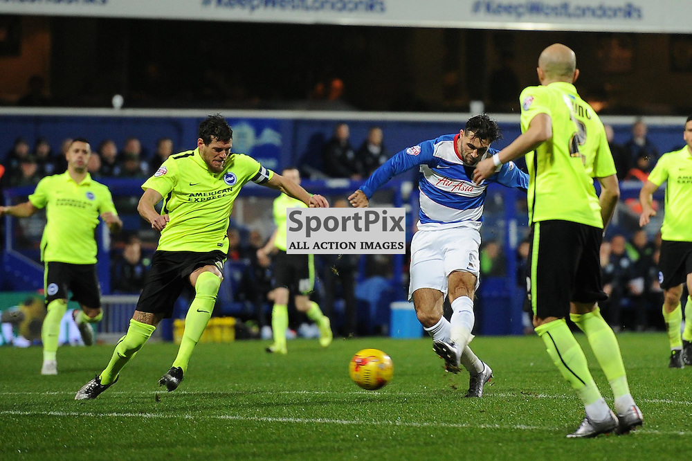 QPRs Charlie Austin gets a shot away during the Queens Park Rangers v Brighton & Hove Albion game in the  Sky Bet Championship on Tuesday 15th Decemeber 2015 at Loftus Road.