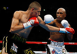 November 10, 2007; New York, NY, USA;   Joel Casamayor (white trunks) and Jose A. Santa Cruz (black trunks) trade punches during their 12 round fight  at Madison Square Garden in New York, NY.  Casamayor retained the Ring Magazine and WBC Interim World Lightweight titles via split decision.