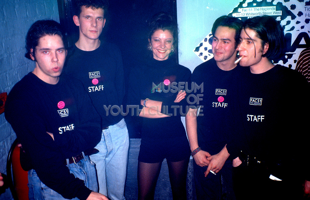 Ange matthews bar manager of the Hacienda taking a break with bar staff at the end of the main bar. Hacienda, Manchester 1989