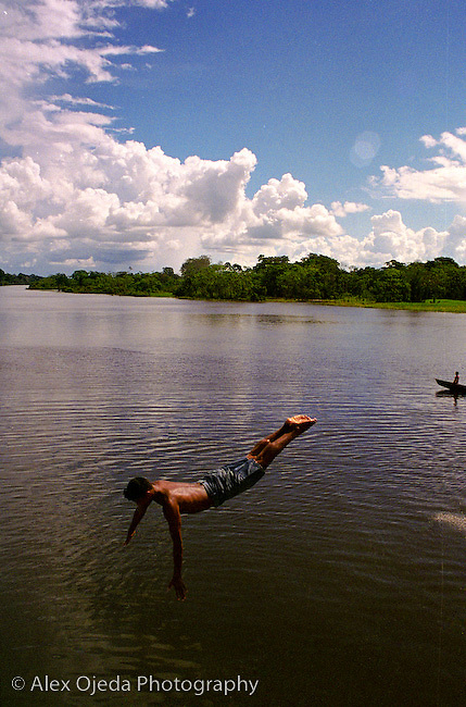 Swimmer taking a dive at the Amazon River, Brazil