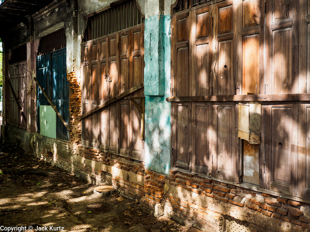 10 APRIL 2017 - BANGKOK, THAILAND: Abandoned and boarded up homes in Pom Mahakan in Bangkok. The people who lived in the homes were evicted in March. The final evictions of the remaining families in Pom Mahakan, a slum community in a 19th century fort in Bangkok, have started. City officials are moving the residents out of the fort. NGOs and historic preservation organizations protested the city's action but city officials did not relent and started evicting the remaining families in early March.   PHOTO BY JACK KURTZ
